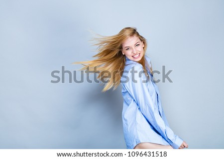 young woman smiling  in shirt ...