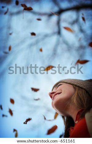 Young woman smiling in the fall leaves