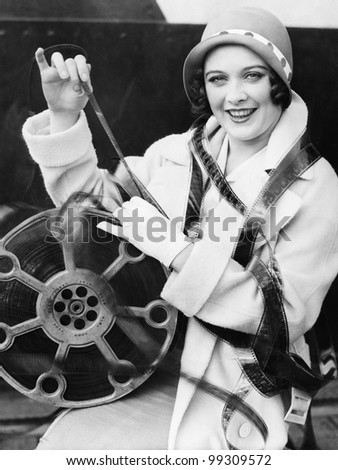 Young woman smiling with film wrapped around her
