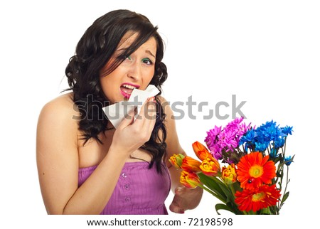 Young woman sneeze and having allergy from spring flowers isolated on ...