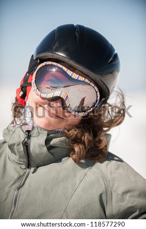 Young Woman Snowboarder Smiling on Snowy Mountain