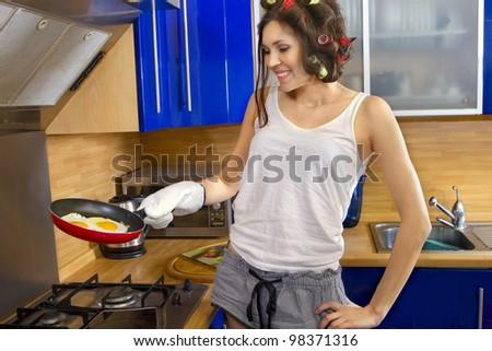Young woman stand with scrambled eggs and pan with big smile