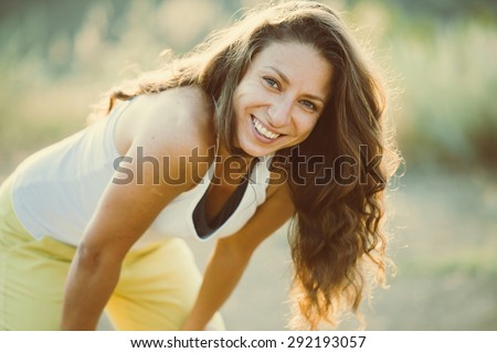 Photo of Young woman standing and resting after run. Wellness and sport concept. Toned image