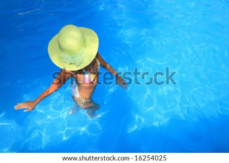 Young woman standing  in a swimming pool