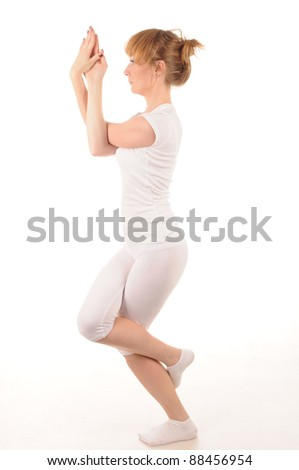 Young woman standing in a yoga pose