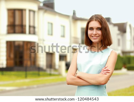Young woman standing near house, isolated on white background