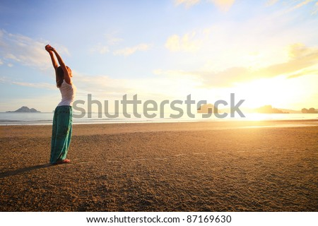 Young woman standing on a sandy beach