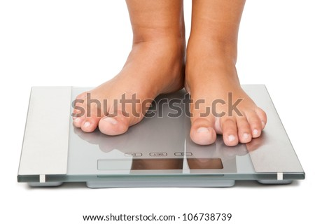 Young woman standing on bathroom scales