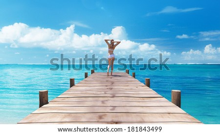 Young woman standing on boardwalk Caribbean sea 3D