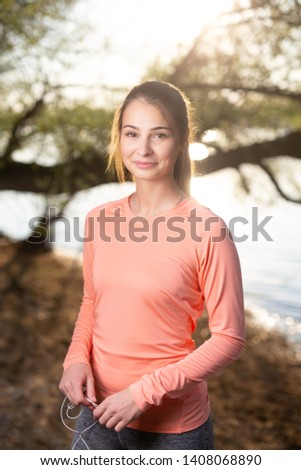 Young woman standing outdoors by the river