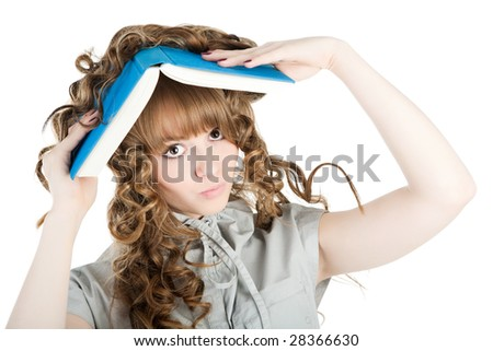 Young woman standing with book solated on white background