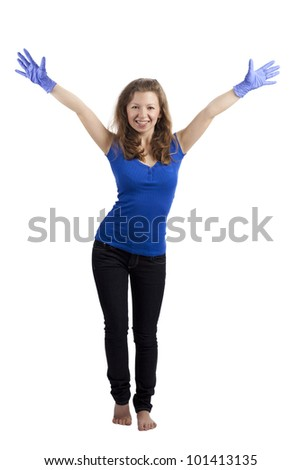 Young woman standing with raised blue-gloved hands