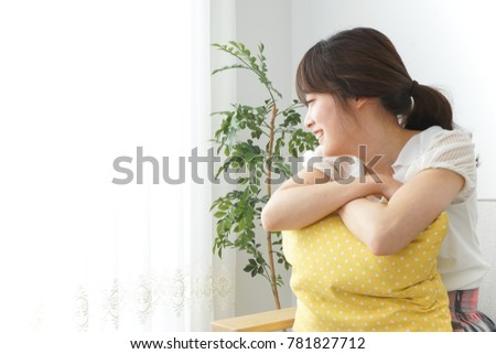 Young woman staying in room #781827712