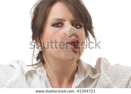 Young woman stopped by an invisible barrier; close-up isolated on a white background.