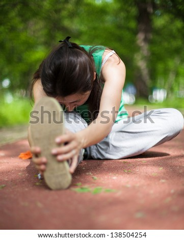 Young woman streching in the park