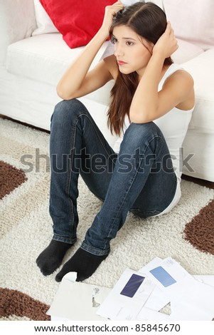 Young woman stressed because of high bills.