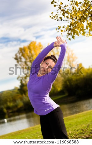 young woman stretching for jogging