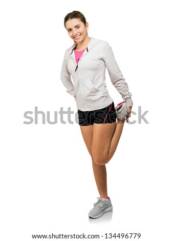 Young Woman Stretching His Leg Up Isolated On White Background