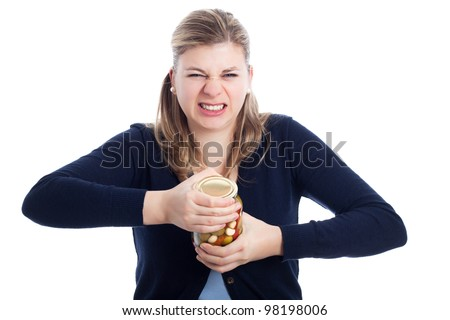 Young woman struggling to open bottle, isolated on white background.