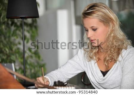 Young woman student doing homework