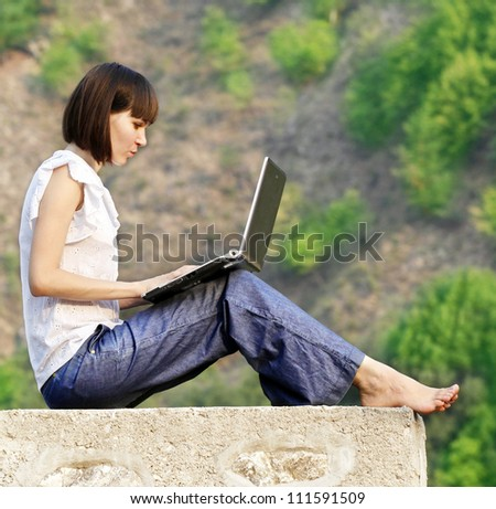 Young woman student learning in the nature