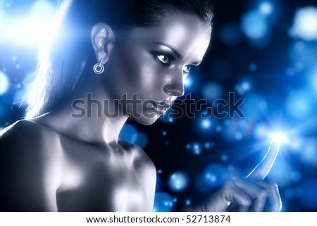 Young woman studio fashion portrait with blue stars.