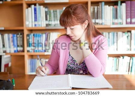 Young woman studying at the library