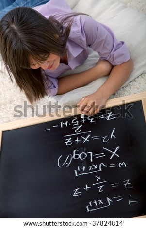 Young woman studying maths with a chalkboard
