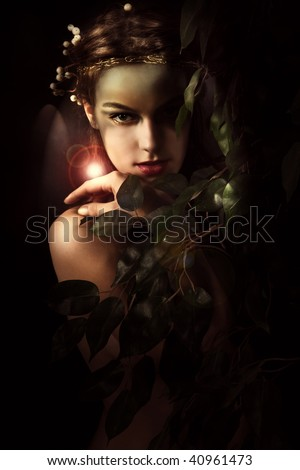 young woman styled as a forest nymph, studio shot