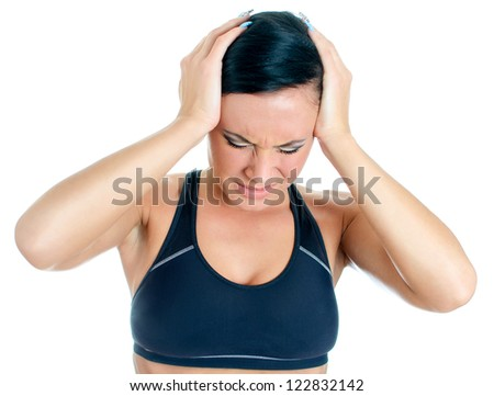 Young woman suffering from headache. Isolated on white