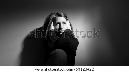 Young woman suffering from severe depression/anxiety