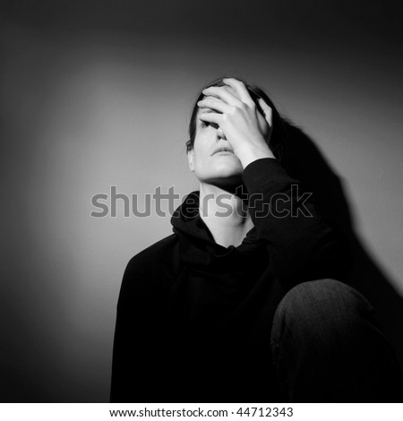 Young woman suffering from severe depression/anxiety  (B&W image)