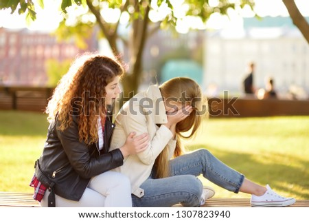 Young woman support and soothe her upsed friend. Two girl during the conversation. Empathy concept