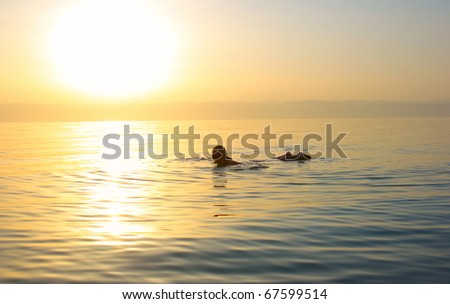 Young woman swimming in the Dead sea