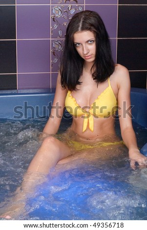 Young woman taking a bath with hydro massage