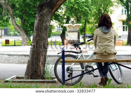 Young woman taking a rest from biking