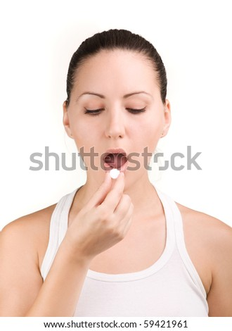 Young woman taking a tablet isolated on white