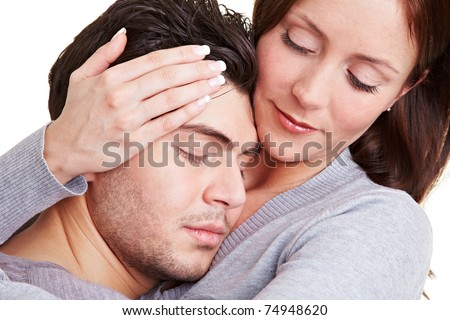 Young woman taking care of her boyfriend while embracing him