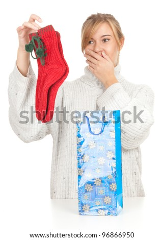 young woman taking out gift from present bag
