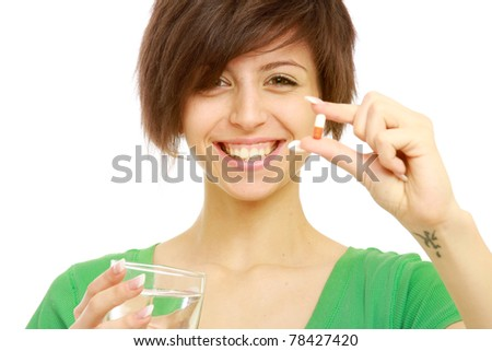young woman taking pill close up