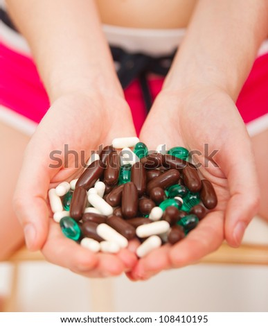 Young woman taking pills