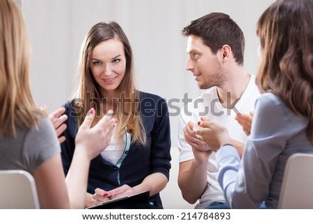 Young woman talking about her life on group therapy