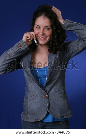 Young woman talking on the phone and smiling. - stock photo
