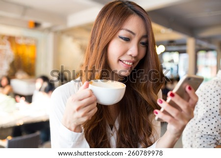 young woman texting or using...