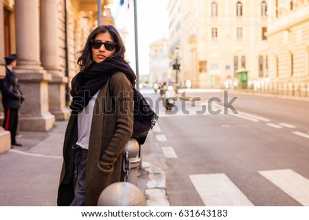 young woman thinking in the city  #631643183