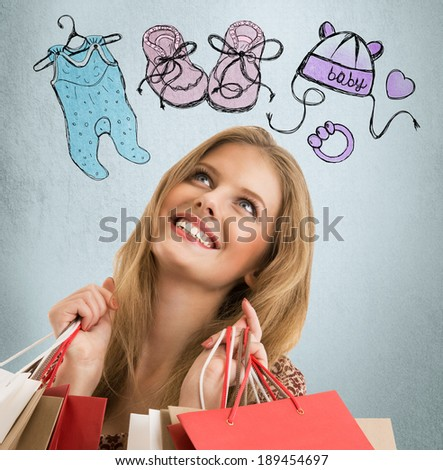 Young woman thinking of her pregnancy plans closeup face portrait and sketches overhead. Planning purchases for newborn baby