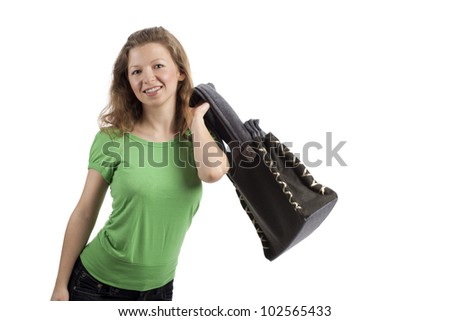 Young woman throwing a bag over her shoulder