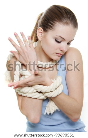 young woman tied up with rope over white