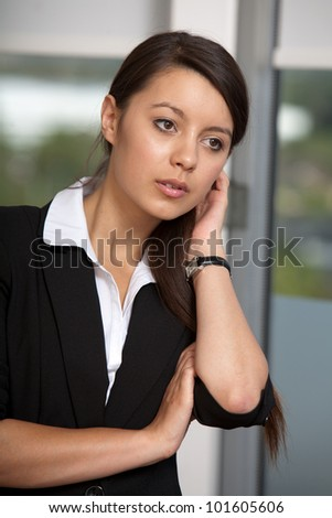 Young woman touch her hair - stock photo