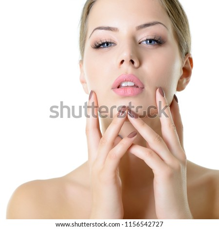 Young woman touching her face and neck. Beauty treatment for young beautiful face. Skin care, beautician treatments, body wax, mink eyelashe, eyebrow grooming, permanent chin hair removal concept